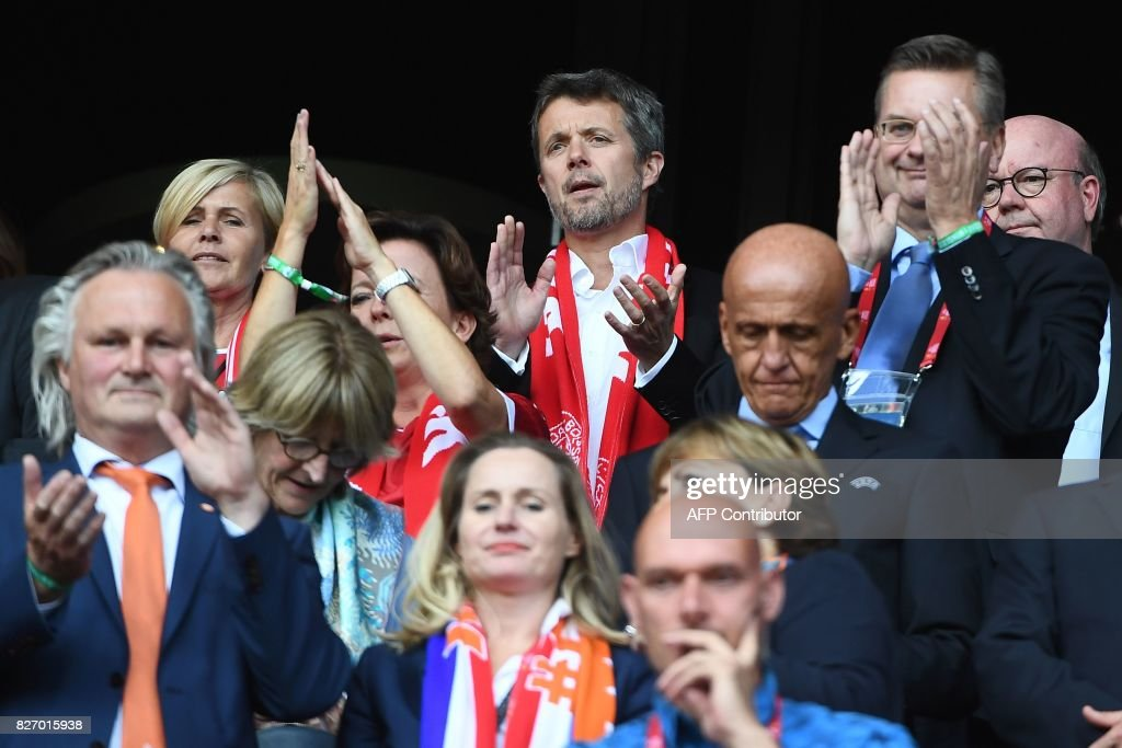 Denmark's Crown Prince Frederik (C) applauds during the UEFA Womens Euro 2017 football tournament final match between Netherlands and Denmark at Fc Twente Stadium in Enschede on August 6, 2017. /
