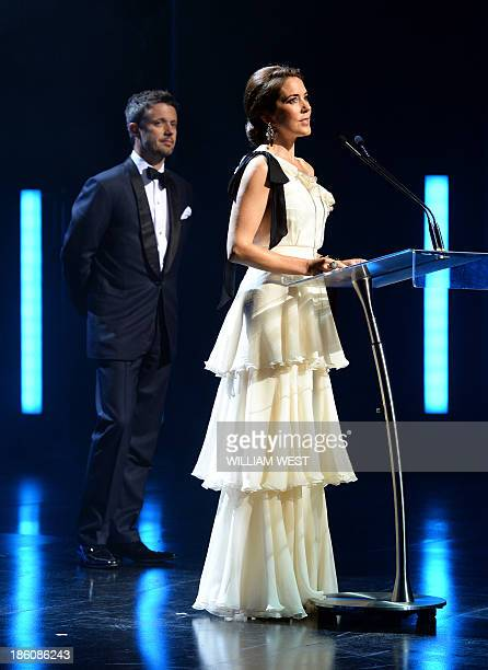 Denmark's Crown Prince Frederik listens to his wife Crown Princess Mary speaking during the Crown Prince Couple Awards 2013 in Sydney on October 28...