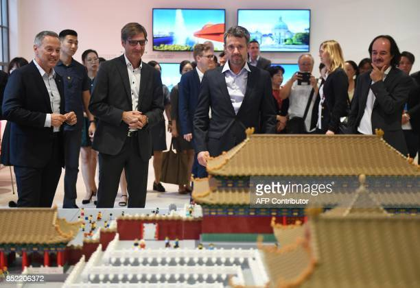 Denmark's Crown Prince Frederik looks at a Lego model of the Forbidden City during the opening of an exhibition titled A Modern Household at the...