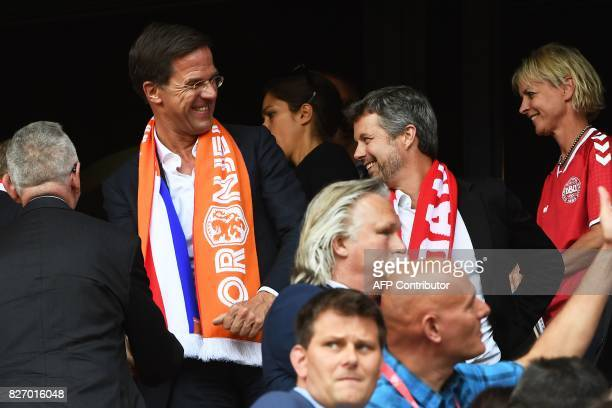Denmark's Crown Prince Frederik smiles as he speaks Dutch Prime Minister Mark Rutte during the UEFA Womens Euro 2017 football tournament final match...