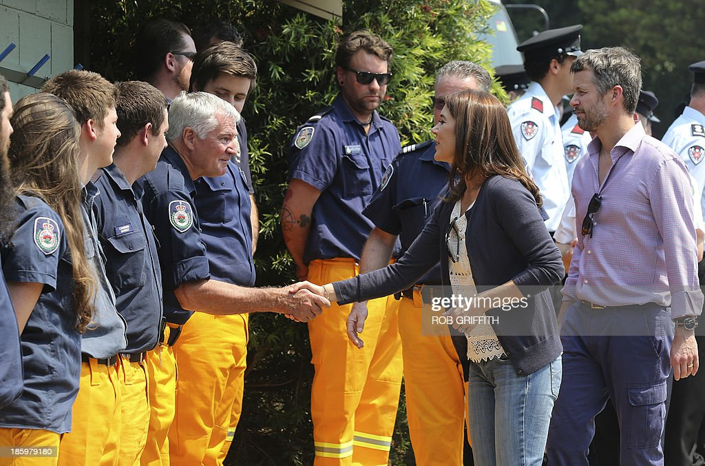 Denmark's Crown Princes Frederick (R) and Princess Mary (2nd R) meet volunteer firefighters at the Winmalee fire station, 85 kms west of Winmalee on October 27, 2013. Mary and her husband, Denmark's Crown Princes Frederick, visited the station to thank firefighters for their work during the bush fires that started October 18, destroying more than 200 properties. Frederick and Mary are in Australia and to take part in the 40th birthday celebrations of the Sydney Opera House. AFP PHOTO / POOL / Rob Griffith