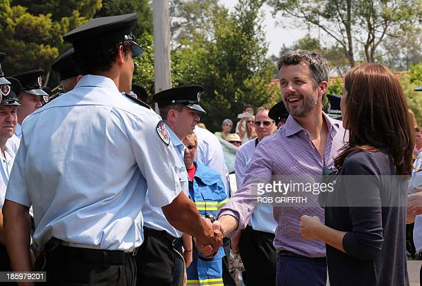 Denmark's Crown Princes Frederick and Princess Mary meet volunteer firefighters at the Winmalee fire station 85 kms west of Winmalee on October 27...