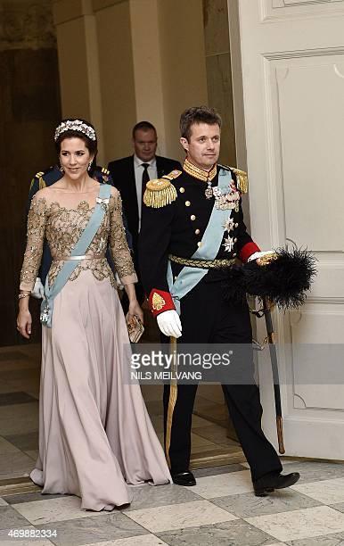 Denmark's Crown Princess Mary and Crown Prince Frederik arrive for Denmark's Queen Margrethe's 75th birthday dinner at Christiansborg Palace on April...