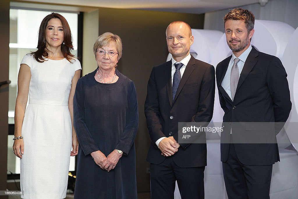 Denmark's Crown Princess Mary, Danish Politician Marianne Jelved, General Manager of ECCO Shoes Morten Lauge and Denmark's Crown Prince Frederik attend an offical ceremony of the Diploma of the Danish Export Association and His Royal Highness Prince Henrik's Medal of Honour to ECCO Shoes Pacific in Sydney on October 28, 2013. Prince Frederik and his whife Princess Mary are on a 5-day visit to Australia to celebrate the 40th anniversary of the Sydney Opera House. AFP PHOTO / POOL / Brendon Thorne