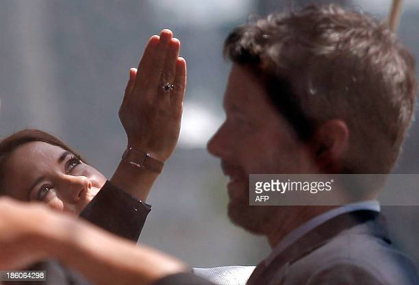 Denmark's Crown Princess Mary looks up at the roof of the Sydney Opera House as she arrives with her husband Crown Prince Frederik for a luncheon...