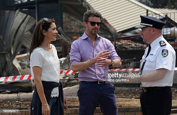 Denmark's Crown Princess Mary Prince Frederick and New South Wales RFS Commissioner Shane Fitzsimmons speak during a tour of bush fire devastation...