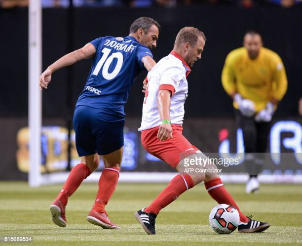 Denmark's Daniel Jensen vies with France's Youri Djorkaeff during the Star Sixes final football match between France and Denmark at the O2 Arena in...