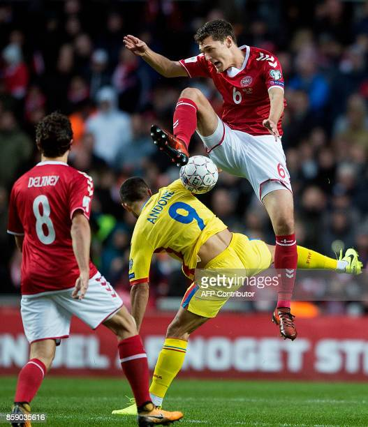 Denmark's defender Andreas Christensen vies with Romania's forward Florin Andone during the FIFA World Cup 2018 qualification football match between...