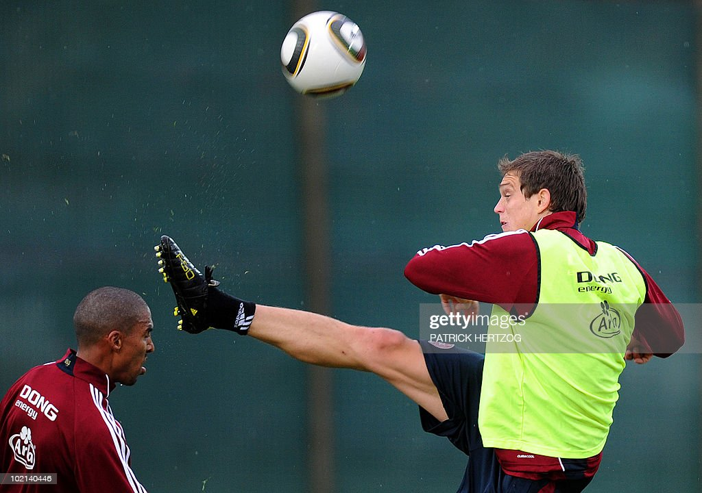 Denmark's defender Daniel Agger (R) vies with teammate Patrick Mtiliga during a training session at Loerie Park in Knysna on June 16, 2010 during the 2010 World Cup tournament in South Africa.
