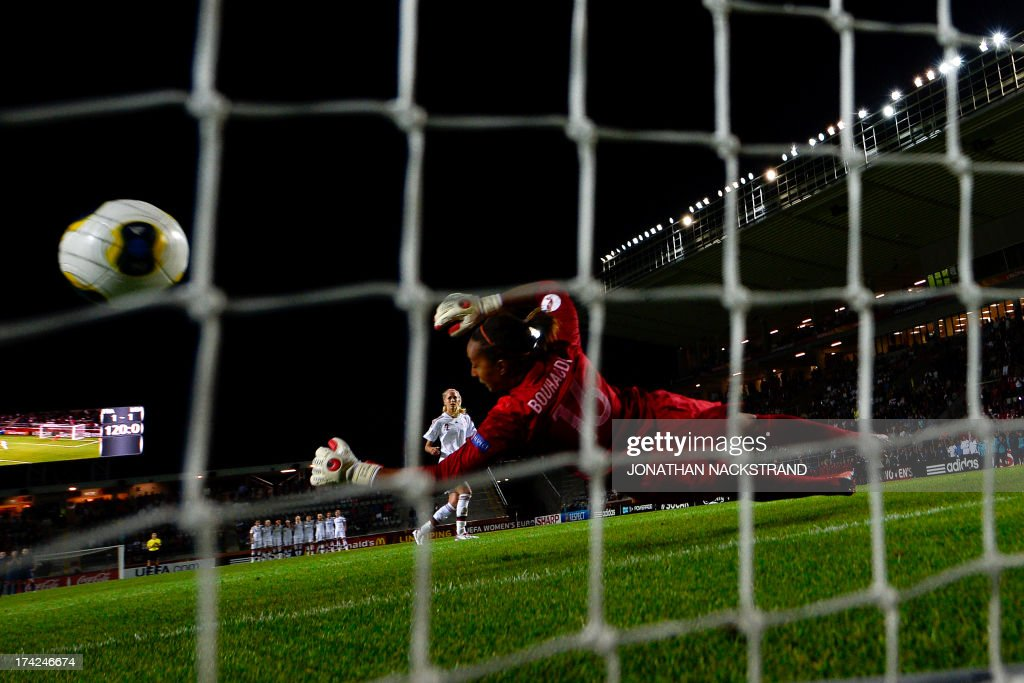 Denmark's defender Line Roddik scores past France's goalkeeper Sarah Bouhaddi during penalty shootout of the UEFA Women's European Championship Euro 2013 quarter final football match France vs Denmark on July 22, 2013 in Linkoping, Sweden.