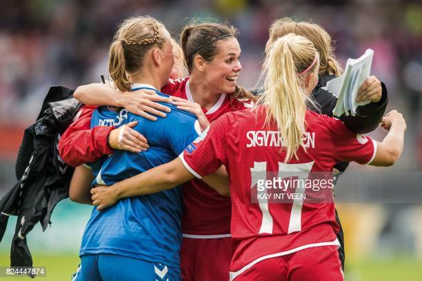 Denmarks' defender Simone Boye Sorensen celebrates with teammates after Denmark defeated Germany in the quarter final match of the UEFA Women's Euro...