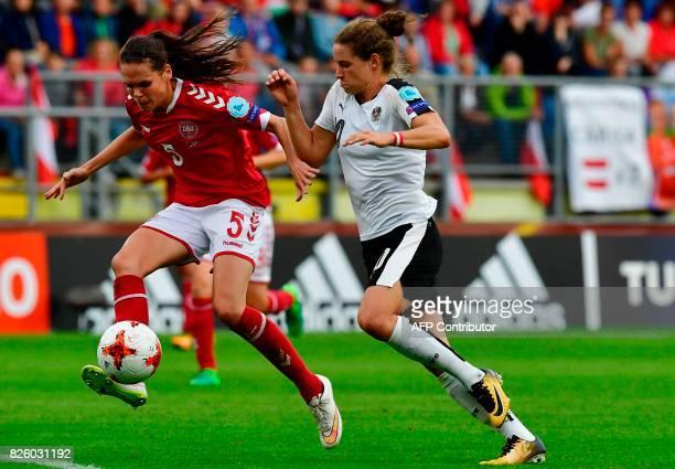 Denmark's defender Simone Boye Sorensen vies for the ball with Austria's forward Nina Burger during the UEFA Womens Euro 2017 football tournament...