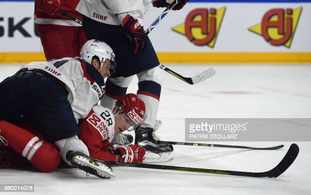Denmark´s Emil Kristensen and US Anders Bjork vie for the puck during IIHF Ice hockey world championship first round match between USA and Denmark in...
