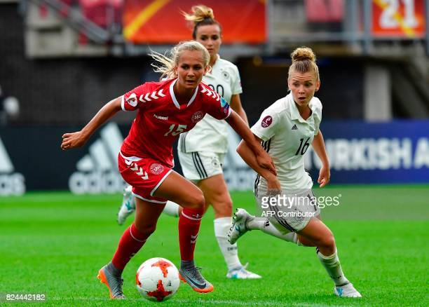 Denmark's forward Frederikke Thogersen fights for the ball with Germany's midfielder Linda Dallmann during the quarterfinal match of UEFA Women's...
