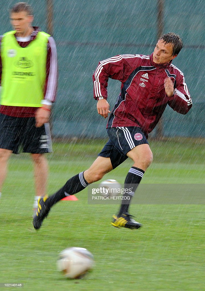 Denmark's forward Jesper Gronkjaer runs under the rain during a training session at Loerie Park in Knysna on June 16, 2010 during the 2010 World Cup tournament in South Africa.