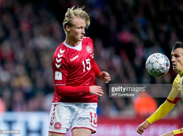 Denmark's forward Kasper Dolberg vies with Romania's Vlad Chiriches during the FIFA World Cup 2018 qualification football match between Denmark and...