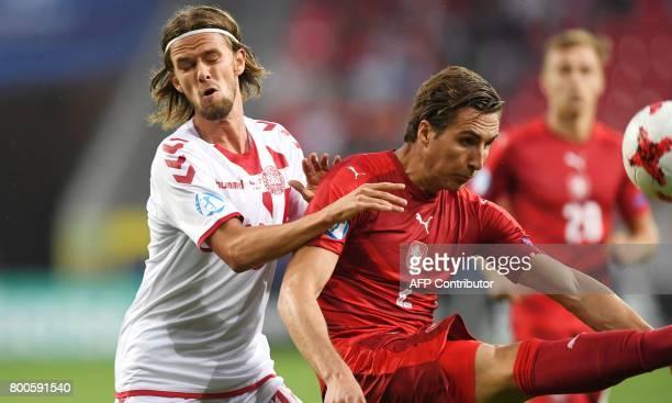 Denmark's forward Lucas Qvistorff Andersen and Czech Republic's defender Stefan Simic vie for the ball during the UEFA U21 European Championship...