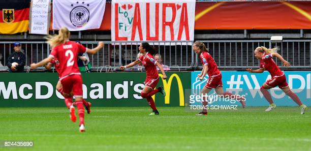 Denmark's forward Nadia Nadim celebrates with teammates after scoring during the quarterfinal UEFA Women's Euro 2017 football match between Germany...