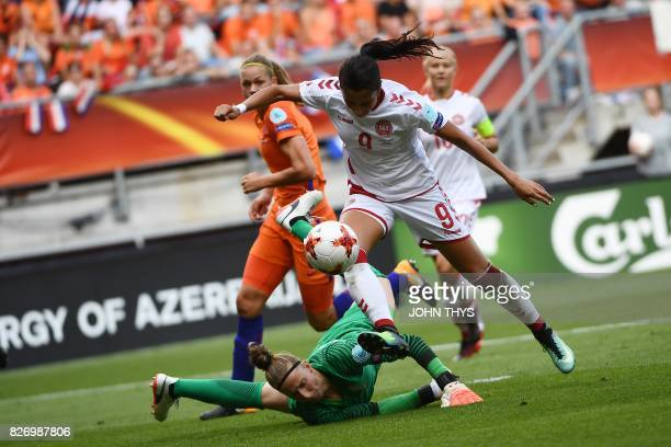 Denmark's forward Nadia Nadim controls the ball as she vies with Netherlands' goalkeeper Sari van Veenendaal during the UEFA Womens Euro 2017...