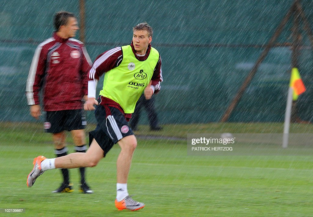 Denmark's forward Nicklas Bendtner runs under the rain during a training session at Loerie Park in Knysna on June 16, 2010 during the 2010 World Cup tournament in South Africa.