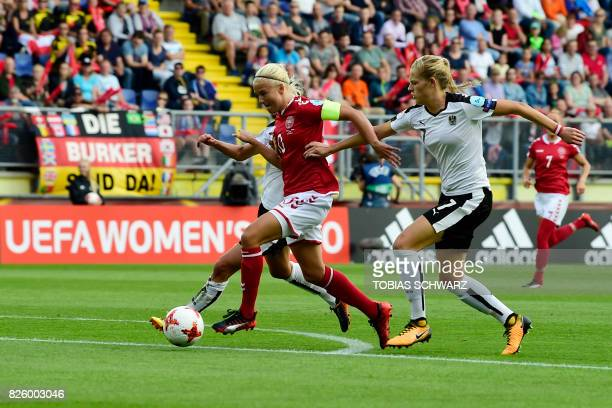 Denmark's forward Pernille Harder vies for the ball with Austria's defender Carina Wenninger during the UEFA Womens Euro 2017 football tournament...