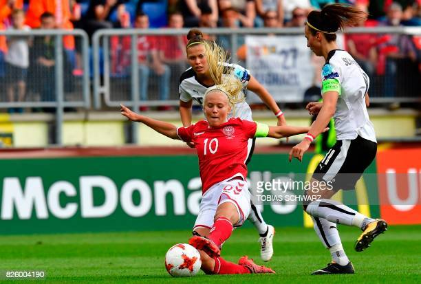 Denmark's forward Pernille Harder vies for the ball with Austria's defender Sophie Maierhofer and Austria's defender Viktoria Schnaderbeck during the...