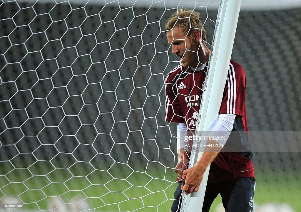 Denmark's forward Soren Larsen moves a goal post during a training session at Loerie Park in Knysna on June 6, 2010 ahead of the 2010 World Cup football tournament in South Africa.