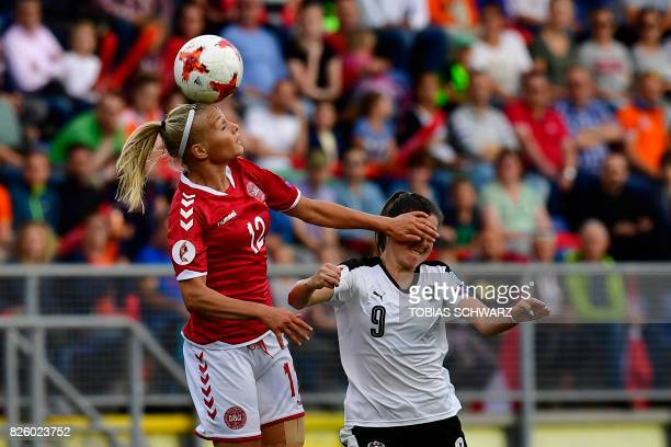 Denmark's forward Stine Larsen jumps for the ball next to Austria's forward Sarah Zadrazil during the UEFA Womens Euro 2017 football tournament...