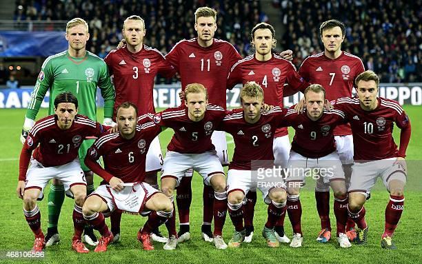 Denmark's goalkeeper Kasper Schmeichel defender Simon Kjær forward Nicklas Bendtner defender Erik Sviatchenko and midfielder William Kvist Denmark's...