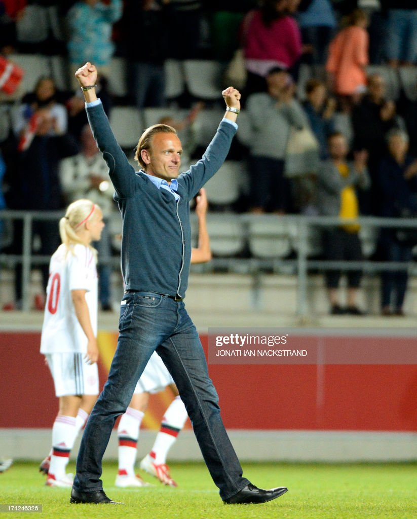 Denmark's head coach Kenneth Heiner-Moller celebrates after winning in the penalty shootout the UEFA Women's European Championship Euro 2013 quarter final football match France vs Denmark on July 22, 2013 in Linkoping, Sweden. AFP PHOTO/JONATHAN NACKSTRAND