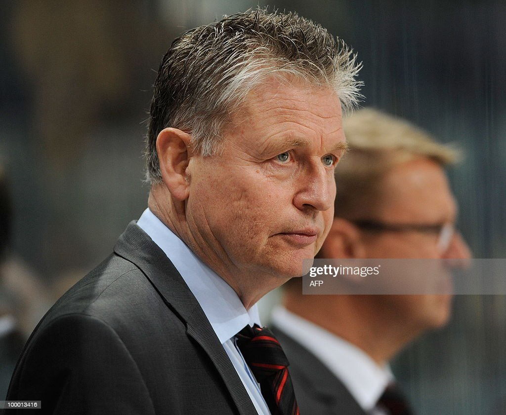 Denmark's head coach Per Backman stands on the sideline ahead of the IIHF Ice Hockey World Championship quarter-final match Sweden vs Denmark in the southern German city of Mannheim on May 20, 2010. The 2010 IIHF Ice Hockey World Championships are taking place in Germany from May 7 to 23, 2010.