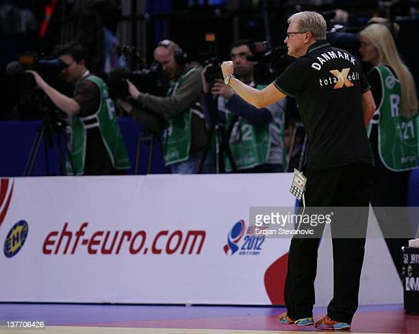 Denmark's head coach Ulrik Wilbek shouts instructions to his team during the Men's European Handball Championship 2012 second round group one match...