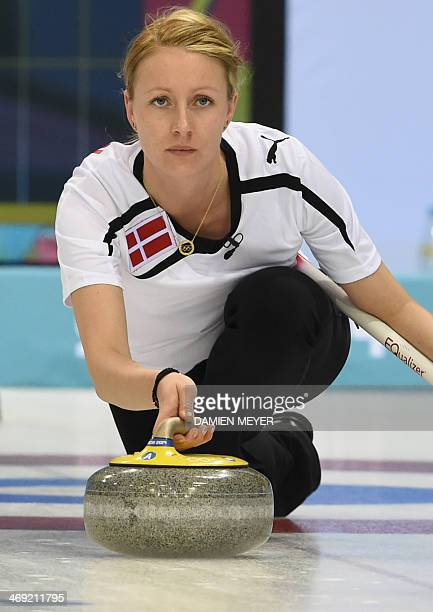 Denmark's Helle Simonsen throws the stone during the Women's Curling Round Robin Session 6 against Sweden at the Ice Cube Curling Center during the...