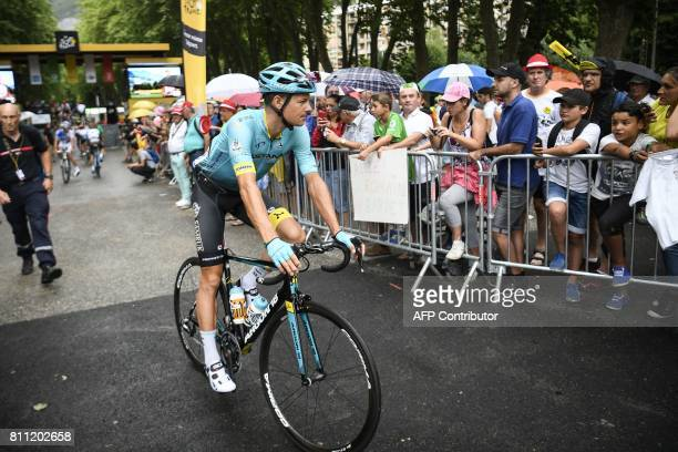 Denmark's Jakob Diemer Fuglsang rides towards the start line prior to the 1815 km ninth stage of the 104th edition of the Tour de France cycling race...