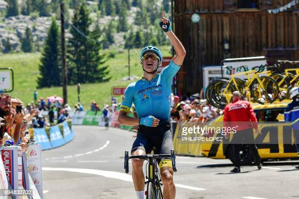 Denmark's Jakob Fuglsang celebrates as he crosses the finish line at the end of the 115 km eighth and last stage of the 69th edition of the Criterium...