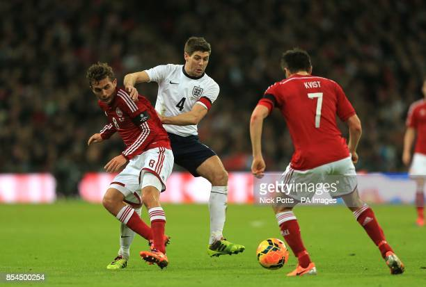 Denmark's Jakob Poulsen and England's Steven Gerrard battle for the ball