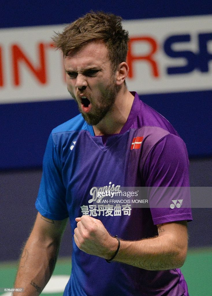 Denmark's Jan O Jorgensen reacts after winning a point to England's Rajiv Ouseph during their men's simple semi-final match Denmark vs. England during the 2016 European badminton championships, on April 30, 2016 in Mouilleron-le-Captif, western France. / AFP / JEAN