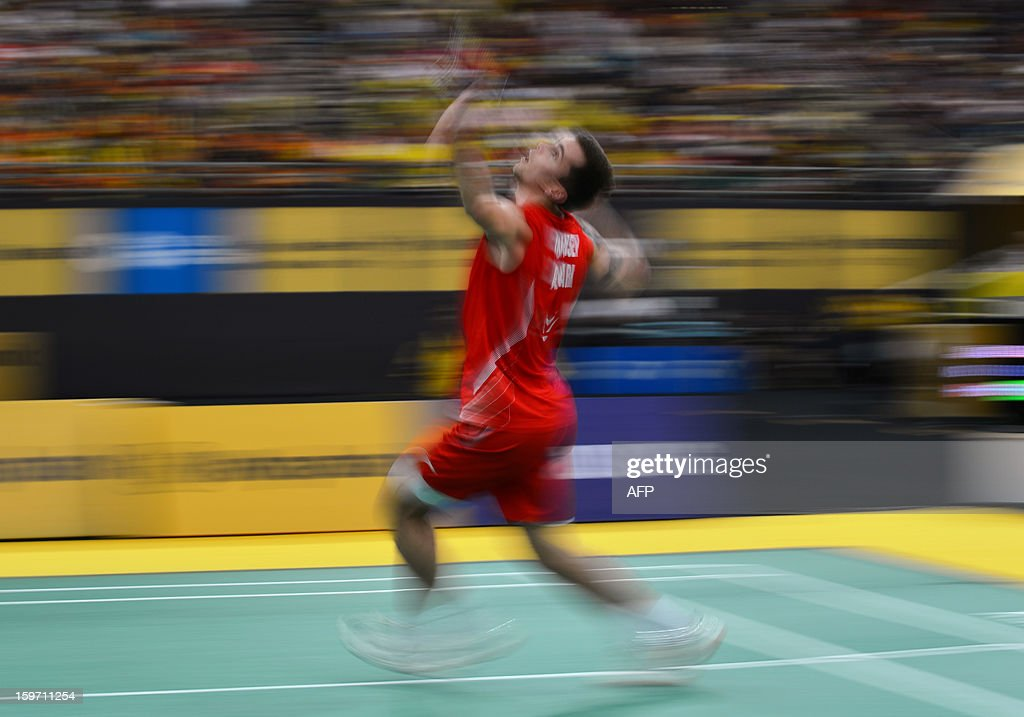 Denmark's Jan O Jorgensen returns a shot against Malaysia's Lee Chong Wei during their men's singles semi-final match at the Malaysia Open Badminton Superseries in Kuala Lumpur on January 19, 2013.