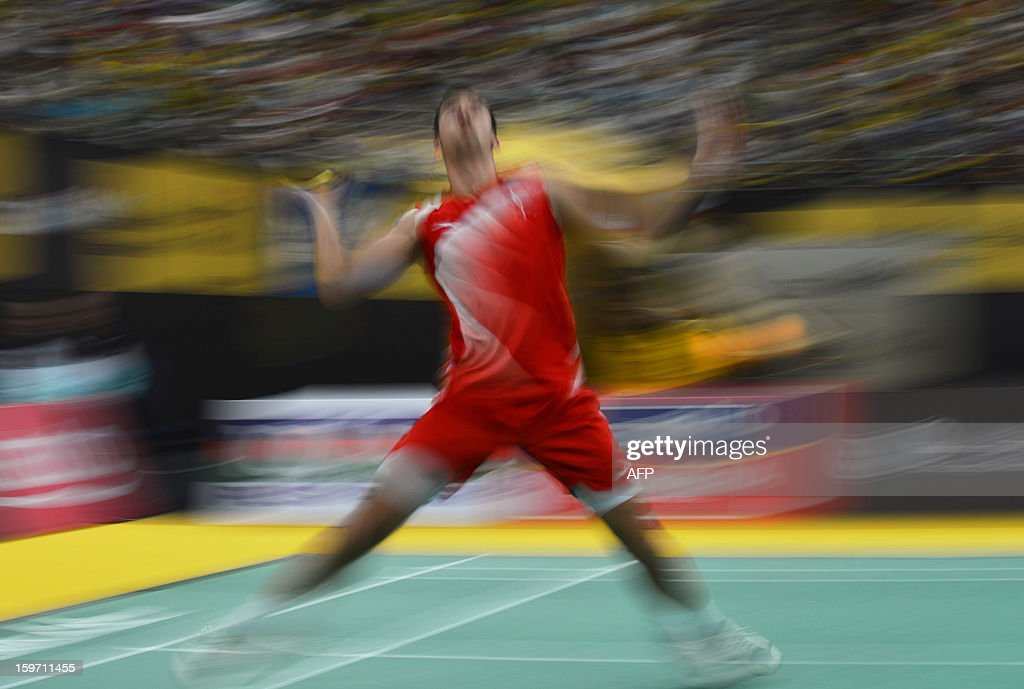 Denmark's Jan O Jorgensen returns a shot against Malaysia's Lee Chong Wei during their men's singles semi-final match at the Malaysia Open Badminton Superseries in Kuala Lumpur on January 19, 2013. AFP PHOTO / MOHD RASFAN