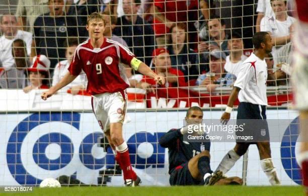 Denmark's Jon Dahl Thomasson scores past England goalkeeper David James