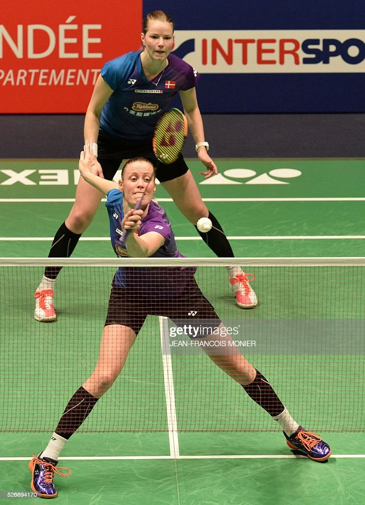 Denmark's Kamilla Rytter Juhl (front) and teammate Christinna Pedersen return the ball to Dutch Eefje Muskens and teammate Selena Piek during their 2016 European Championships Badminton double women's final match, between Denmark and Netherlands, on May 1, 2016 in Mouilleron-le-Captif, western France. / AFP / JEAN