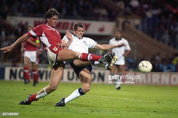 Denmark's Kent Nielsen and England's Steve Bull battle for the ball