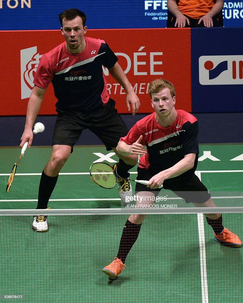 Denmark's Kim Astrup (front), flanked by teammate Anders Skaarup Rasmussen (rear), prepares to return a shot against Russia's players Ivan Sozonov and Ivan Sozonov during the 2016 European Badminton Championships Men's double semi-final match between Denmark and Russia, on April 30, 2016 in Mouilleron-le-Captif, western France. / AFP / JEAN