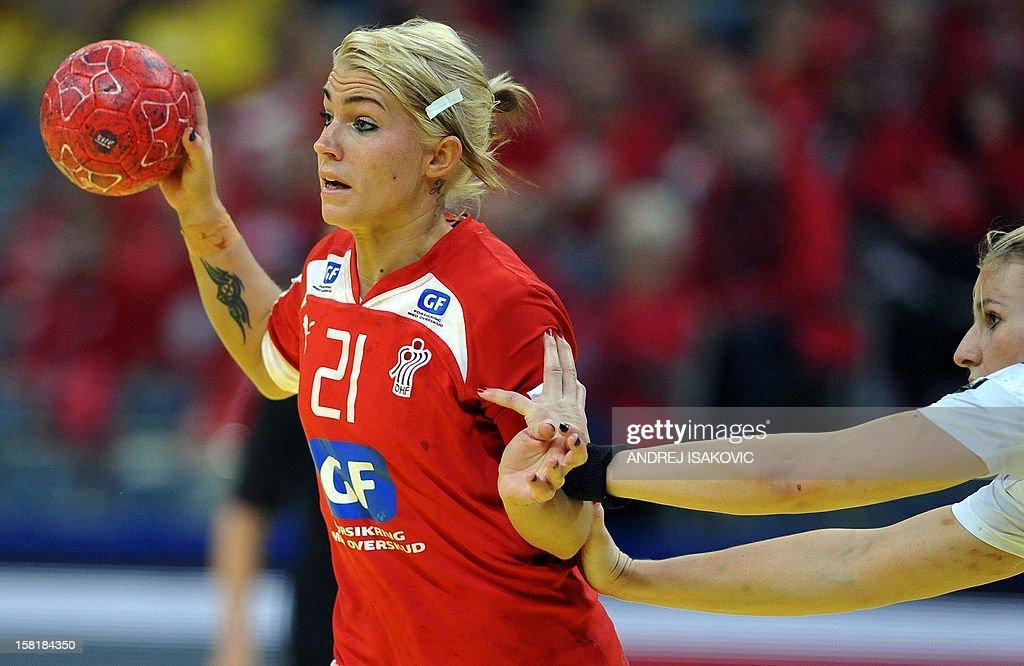 Denmark's Kristina Kristiansen (L) vies with Czech's Pavla Poznarova (R) during their Women's EHF Euro 2012 Handball Championship match Czech Republic vs Denmark on December 10, 2012, at the Belgrade Arena.