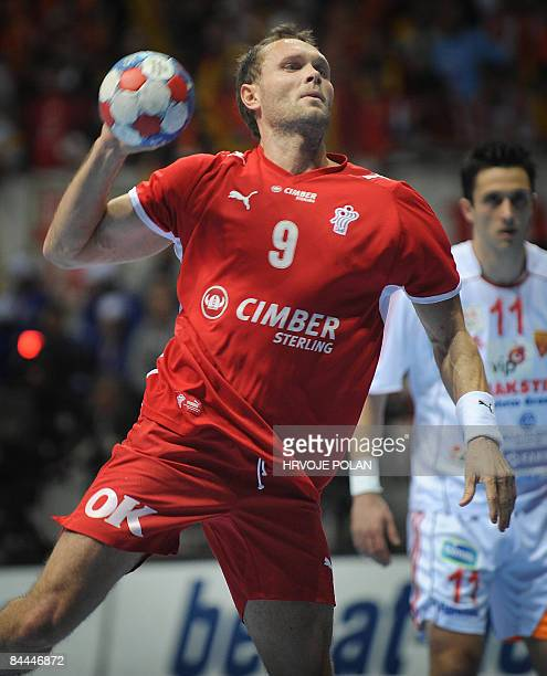 Denmark's Lars Christiansen tries to score in front of Macedonia's Vladimir Temelkov during their World Handball Championship match in Zadar on...
