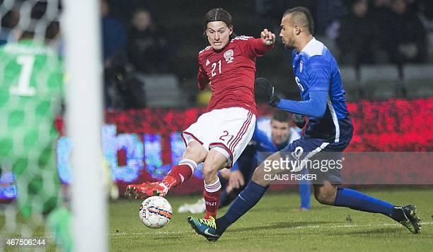 Denmark's Lasse Vibe and USA's John Brooks vie for the ball during the friendly football match Denmark vs USA in Aarhus Denmark on March 25 2015 AFP...