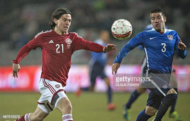 Denmark's Lasse Vibe vies for the ball with the US's Greg Garza during the friendly football match Denmark vs USA in Aarhus Denmark on March 25 2015...