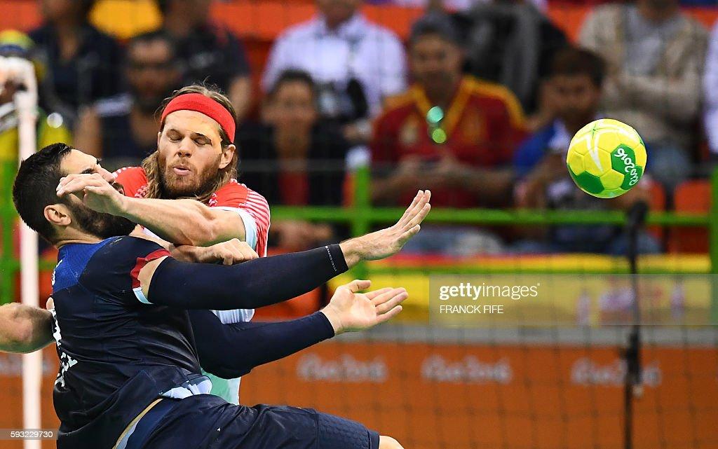 TOPSHOT Denmark's left back Mikkel Hansen blocks France's centre back Nikola Karabatic during the men's Gold Medal handball match Denmark vs France...