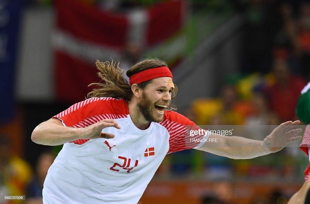 TOPSHOT Denmark's left back Mikkel Hansen celebrates winning the men's Gold Medal handball match Denmark vs France for the Rio 2016 Olympics Games at...