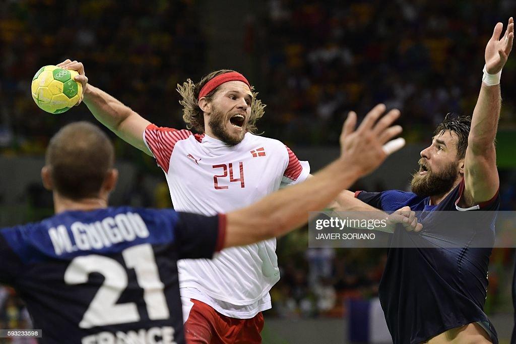 TOPSHOT Denmark's left back Mikkel Hansen jumps to shoot past France's pivot Luka Karabatic during the men's Gold Medal handball match Denmark vs...